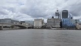 Panning shot of a bridge on Thames river and high raise buildings on the riverside. London.  - 219724740