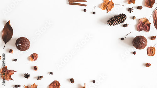Fototapeta Autumn composition. Frame made of autumn things on white background. Flat lay, top view, copy space