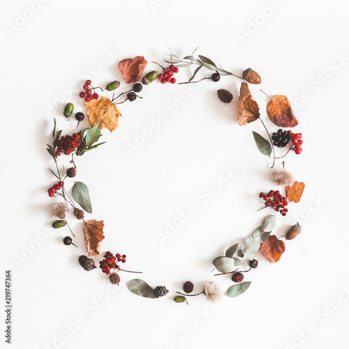 Autumn composition. Wreath made of eucalyptus branches, rose flowers, dried leaves on white background. Autumn, fall concept. Flat lay, top view, copy space, square - 219747364