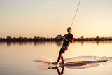 Wakeboarding. Athlete silhouette with splash of water - 219752732