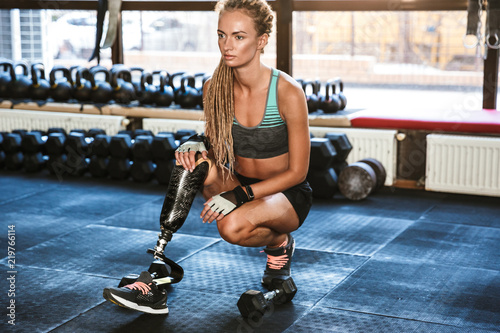 Portrait Of Fitness Disabled Woman In Tracksuit Doing