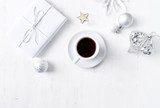Christmas present, ornaments and a cup of coffee on white painted wooden background. Symbolic image. Flatlay. Copy space - 219767511
