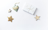 Christmas present with Christmas decorations on white background. Flatlay.  Symbolic image. Copy space - 219767539