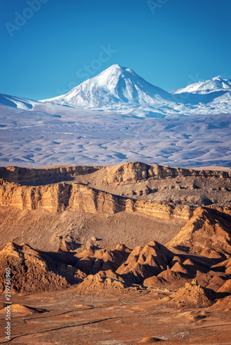 Panorama of Moon Valley in Atacama desert, snowy Andes mountain range in the background, Chile - 219768960