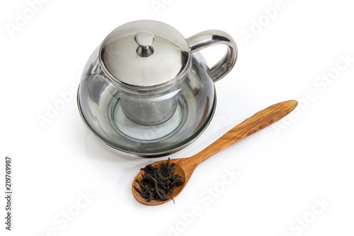 Fototapeta Empty glass teapot and dried tea leaves in wooden spoon