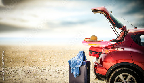Autumn trip with red car and sea landscape