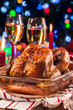 Baked or roasted whole chicken on Christmas table - 219774168
