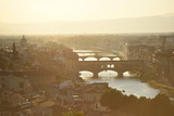 Bridges in sunset in Florence, Italy - 219776133