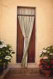 Closed door with curtain in Tuscany, Italy - 219776999