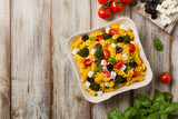 Salad with pasta and feta cheese