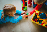 kids play with plastic blocks, learning concept - 219793533