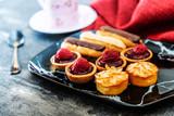 Mixed dessert Raspberry tartlet, Eclair Puffs, almond lemon - 219793952