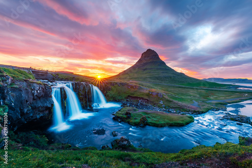 Colorful sunrise on Kirkjufellsfoss waterfall. Amazing morning scene near Kirkjufell volkano, Iceland, Europe. - 219798104