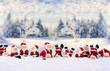 Leinwanddruck Bild - Weihnachtsmänner vor Winterlandschaft