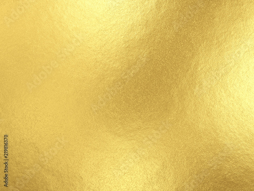 Gold foil background with light reflections