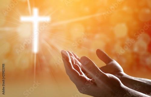 Leinwandbild Motiv Hands of human praying on blurred background