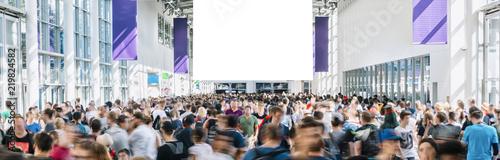 Leinwandbild Motiv blurred people at a games trade fair hall