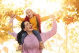 family on autumn walk - 219825982