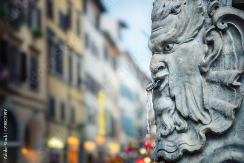 Fototapeta Fountain with drinking water on a street in Florence, Italy