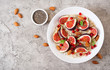 Leinwanddruck Bild - Delicious and healthy oatmeal with figs, almond and chia seeds. Healthy breakfast. Fitness food. Proper nutrition. Flat lay. Top view.