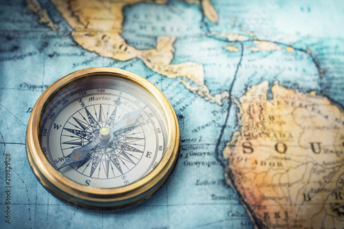 Magnetic compass on world map Travel, geography, navigation, tourism