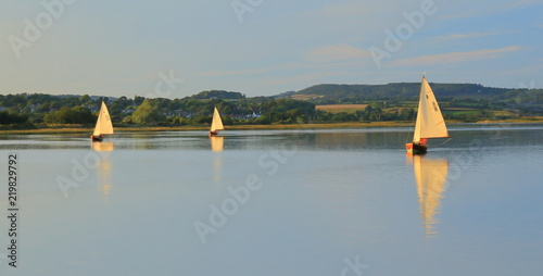 Sailing boats on the river Axe near town of Seaton in East Devon