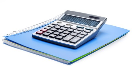 Calculator on top of a notebook © BillionPhotos.com