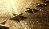 Golden stars in high relief. Concept of good qualification. - 219865395