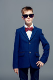 posing in sunglasses and classic suit - 219872167