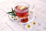 cup of tea with chamomile flowers on rustic background - 219872759