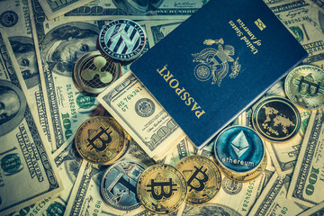 Crypto coins on one hundred dollar bills and american passport