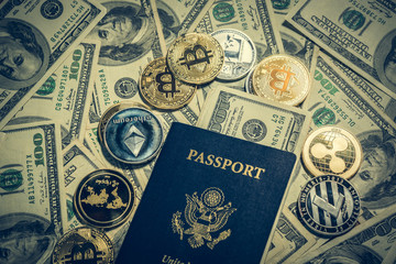 Cryptocurrency coins, one hundred dollar bills and american passport