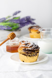 Buns (craffins) with poppy seeds and ice powder
