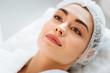 Leinwanddruck Bild - I am ready. Joyful nice woman lying on a medical bed while waiting for a beauty procedure