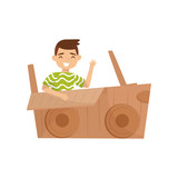 Cheerful little boy sitting in car made of cardboard box and waving hand. Childhood theme. Flat vector design