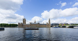LONDON, UK - 15 Sep 2017: The Palace of Westminster, home of the UK parliament, sits on the banks of the Thames river in London, UK. - 219910131