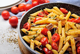 Pasta, penne with cherry tomatoes, aubergines, garlic, oregano and extra virgin olive oil.