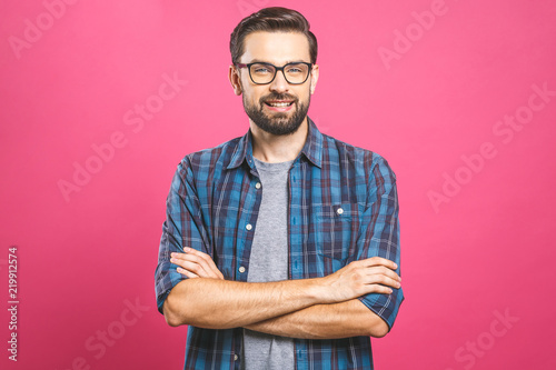 Young man with emotions on his face with a beard on a pink background, logo, copy space. - 219912574