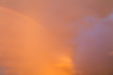 Rainbow in the sky at sunset as background © schankz