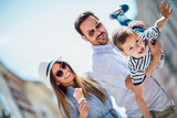 Happy family having fun outdoor after shopping - 219913303