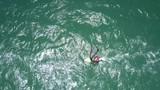 surfer beginner trains on heavy ocean waves - 219913761