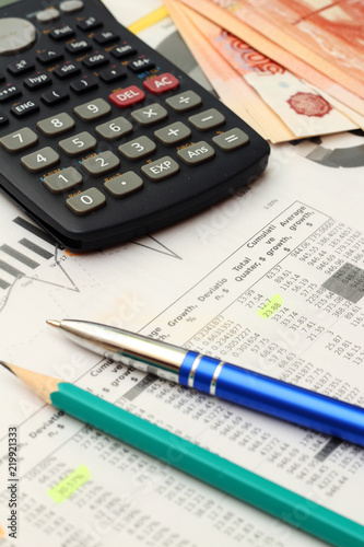 Business concept with a report, money and a calculator - 219921333