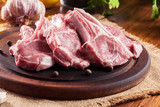 Raw fresh lamb chops on wooden cutting board - 219927775