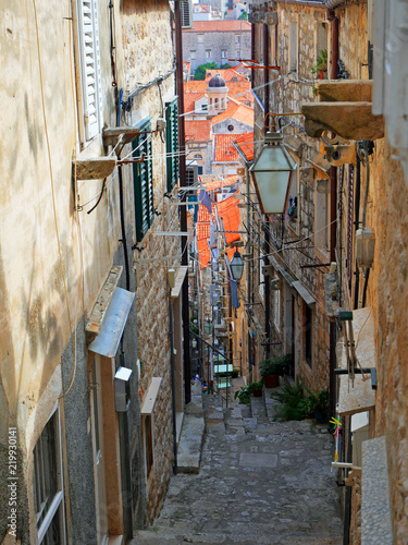 Fototapeta Famous narrow alley of Dubrovnik old town, Croatia, Europe. Prominent travel destination of Croatia. UNESCO World Heritage Sites.