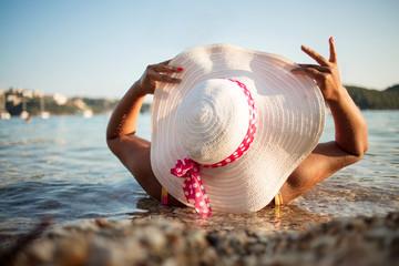 Woman relaxing on luxury beach
