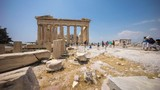 Time lapse view of the Parthenon in Acropolis in Athens, Greece. People can be seen walking around the ruins and taking photographs. - 219962999