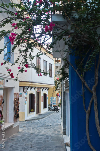 Fototapeta Narrow alleys with traditional greek houses at Skopelos old town, sunset at Skopelos island, Greece