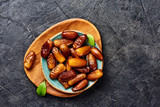 Dried dates fruits on plate with copy space. Top view of pitted dates. - 220001746