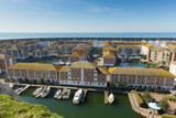 Brighton marina with homes, boats and yachts on a beautiful day in East Sussex England UK near Eastbourne  - 220002161
