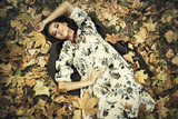 lying on the ground in autumn - 220004525